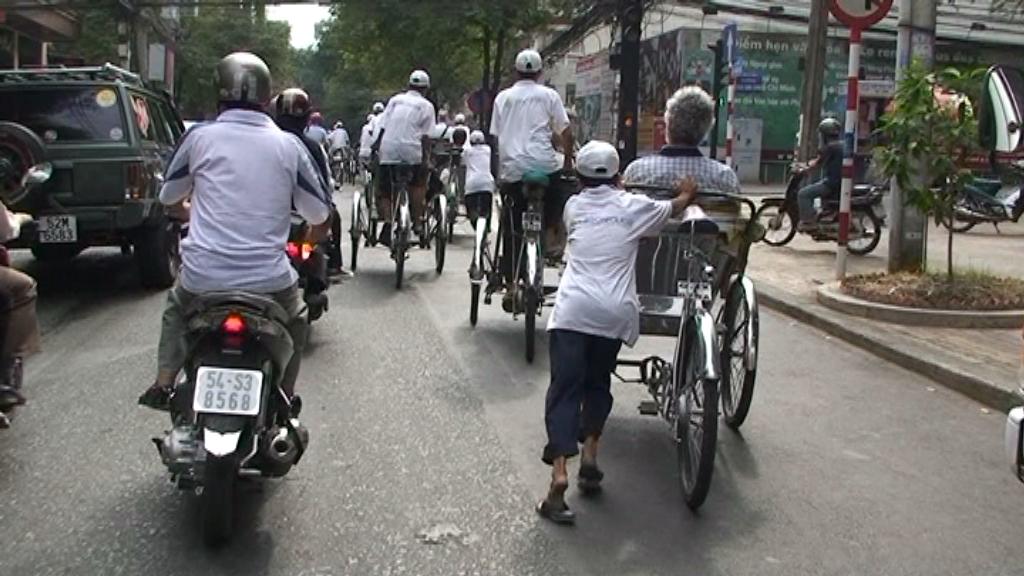 Schon fast auf verlorenem Posten: Fahrrad-Rikschas in Ho-Chi-Minh-Stadt